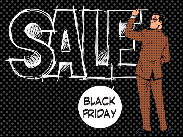 Black Friday businessman writes sale pop art retro style
